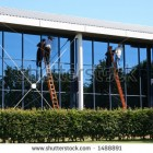 stock-photo-two-window-cleaners-at-work-1488891